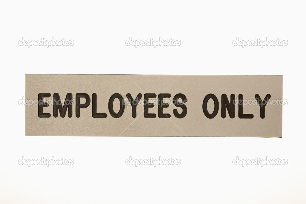 Employees only sign against white background.  Stock Photo #9299927