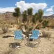 Royalty-Free Stock Photo: Empty chairs in desert.
