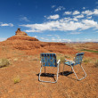 Lawn chairs in desert. — Stock Photo