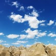 Mountains and Blue Sky in the South Dakota Badlands - Stock Photo