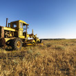 Old Grader in Field - Stock Photo