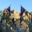 Stock Photo: Mount Rushmore with flags.
