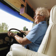 Senior woman driving RV. — Foto de Stock