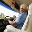 Senior woman driving RV. — Foto Stock