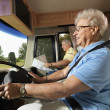 Senior woman driving RV. — Stock Photo