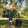 Stock Photo: Senior man and child playing.