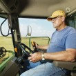 Stock Photo: Farmer in combine.