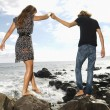 Young Couple Walking at Beach — Stock Photo #9305241