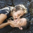 Attractive Young Couple on Rocks Smiling — Stock Photo