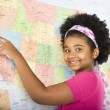Girl pointing to map. — Stock Photo