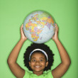 Girl with globe on head. — Stock Photo #9305857