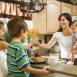 Stock Photo: Mom giving kids breakfast.