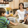 Stock Photo: Mom and children in kitchen.
