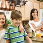 Family in kitchen. — Stock Photo