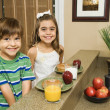 Stock Photo: Kids eating breakfast.