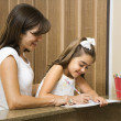 Stock Photo: Mom helping daughter.