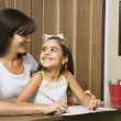 Stock Photo: Mother helping daughter.