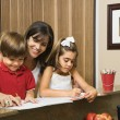 Stock Photo: Family doing homework.