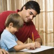 Dad helping son. - Stock Photo