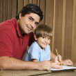 Dad and son with homework. — Stock fotografie