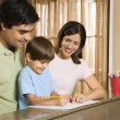Family with homework. — Stock Photo