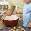 Dad and son making cookies. — Stock Photo #9306012