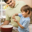 Dad and son making cookies. — Stock Photo