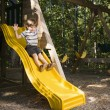 Boy on slide. — Stock Photo
