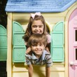 Stock Photo: Kids in playhouse.