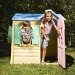 Kids in playhouse. — Stock Photo