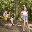 Kids on swing set. — Stock Photo