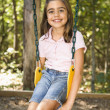 Girl on swing. — Stock Photo