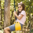 Stock Photo: Girl swinging.