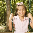 Stock Photo: Girl portrait on swing.