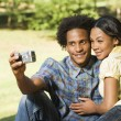 Couple taking pictures. — Stock Photo