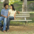 Couple on park bench. — Stock Photo