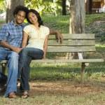 Couple sitting together. — Stock Photo