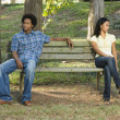 Couple sitting apart. — Stock Photo