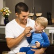 Father feeding son. — Stock Photo