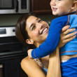 Mom lifting happy child. — Stock Photo #9306359