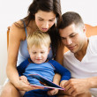 Stock Photo: Family reading.