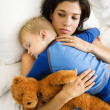 Foto Stock: Mom with sleeping child.