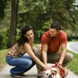 Couple petting dog. — Stock Photo