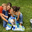 Family giving dog a bath. — Foto Stock