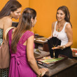Customers and sales clerk. - Stock Photo