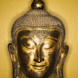 Bronze Buddha head. - Stock Photo