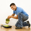 Man pouring paint. — Stock Photo