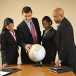Businesspeople with globe. — Stock Photo