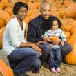 Family picking pumpkin. — Stock Photo #9307337