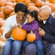 Stock Photo: Family holding pumpkins.